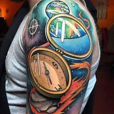 Colorful custom compass and space themed tattoo by Green Bay, WI tattoo artist Greg Counard