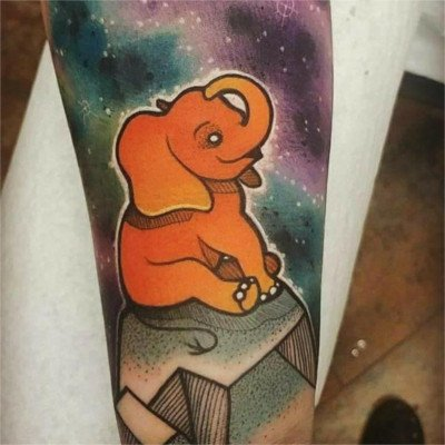 Colorful custom elephant tattoo by Green Bay, WI tattoo artist Greg Counard