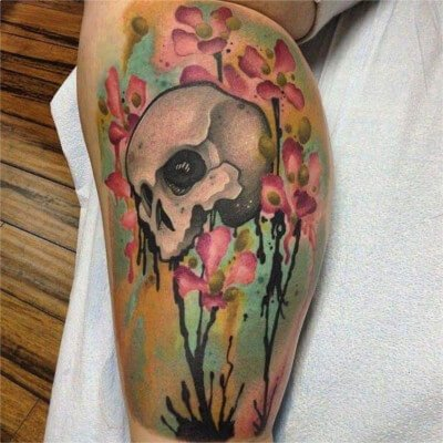 Colorful custom skull with watercolor flowers tattoo by Green Bay, WI tattoo artist Greg Counard