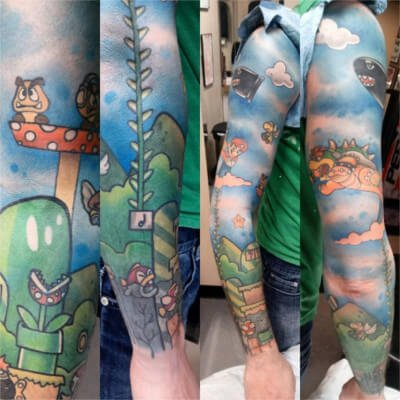 Colorful custom Super Mario Bros themed sleeve tattoo by green bay tattoo artist Greg Counard