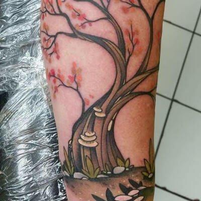 Colorful custom tree tattoo by Green Bay, WI tattoo artist Greg Counard