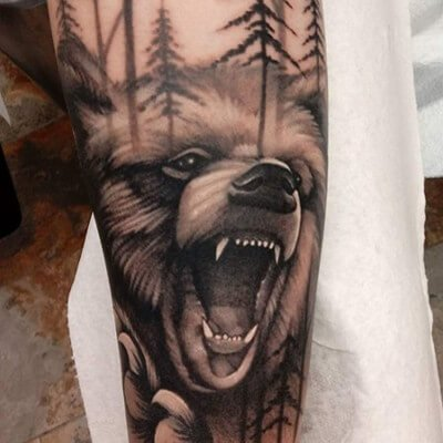 Colorful black and grey bear tattoo by Green Bay, WI tattoo artist Greg Counard