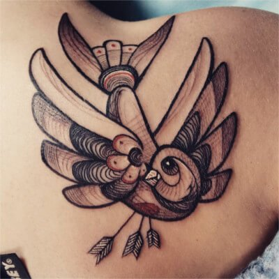 custom bird tattoo by Green Bay, WI tattoo artist Greg Counard