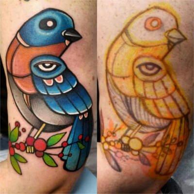 Colorful custom bird tattoo by Green Bay, WI tattoo artist Greg Counard