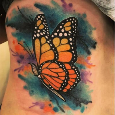 Colorful custom butterfly tattoo by Green Bay, WI tattoo artist Greg Counard