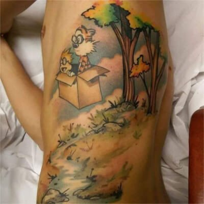 Colorful custom Calvin and Hobbs Themed tattoo by Green Bay, WI tattoo artist Greg Counard