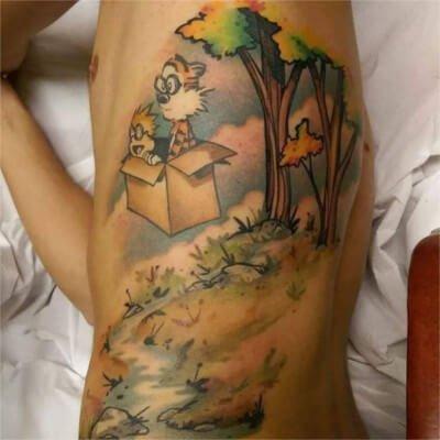 Colorful custom Calvin and Hobbs Themed tattoo by Green Bay, WI tattoo artist Greg Counard
