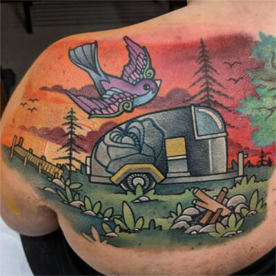 Colorful custom camping scene tattoo by Green Bay, WI tattoo artist Greg Counard