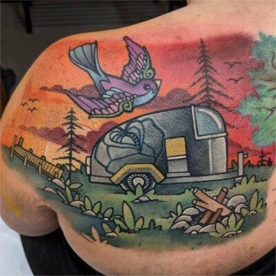 Colorful custom camping scene tattoo by Green Bay, WI tattoo artist Greg Counard