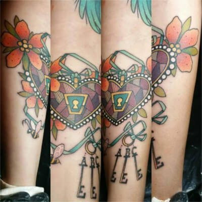 Colorful custom heart and keys tattoo by Green Bay, WI tattoo artist Greg Counard
