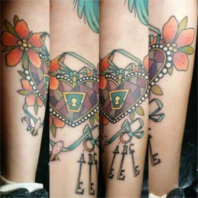 Colorful custom heart and keys tattoo by Green Bay, WI tattoo artist Greg Counard