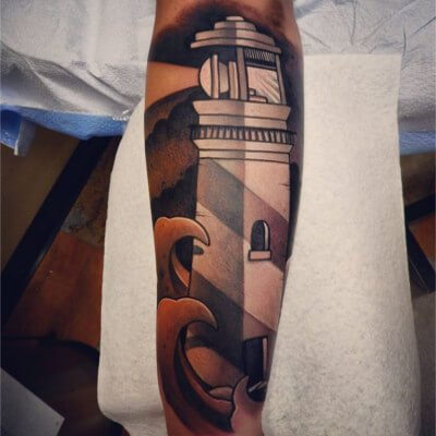 Colorful custom lighthouse tattoo by Green Bay, WI tattoo artist Greg Counard