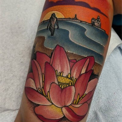 Colorful custom lotus and beach scene tattoo by Green Bay, WI tattoo artist Greg Counard