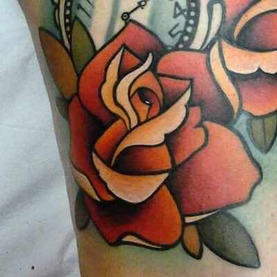 Colorful custom rose tattoo by Green Bay, WI tattoo artist Greg Counard