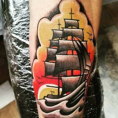 Colorful custom nautical/traditional ship tattoo by Green Bay, WI tattoo artist Greg Counard