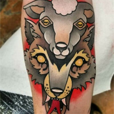 Colorful custom wolf and sheep tattoo by Green Bay, WI tattoo artist Greg Counard