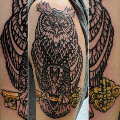 Colorful custom owl tattoo by Green Bay, WI tattoo artist Greg Counard