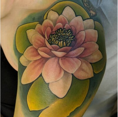 Colorful custom lily pad tattoo by Green Bay, WI tattoo artist Greg Counard