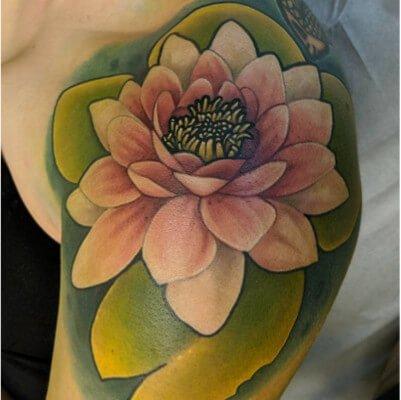 Colorful custom lily pad tattoo by Green Bay, WI tattoo artist Greg Counard