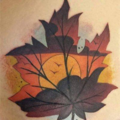 Colorful custom maple leaf tattoo by Green Bay, WI tattoo artist Greg Counard
