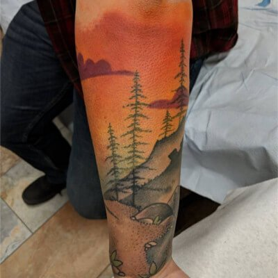 Colorful custom nature themed tattoo by Green Bay, WI tattoo artist Greg Counard