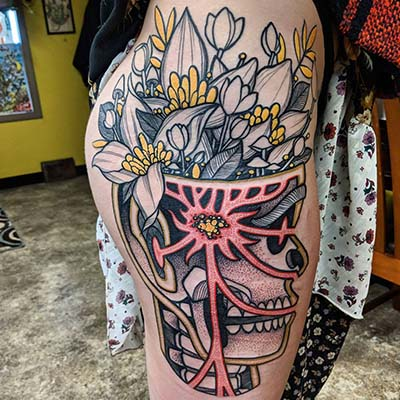 skull and flowers tattoo by greg counard