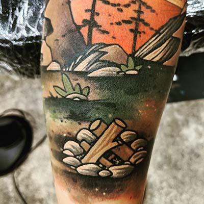 campfire scene tattoo by green bay tattoo artist greg counard