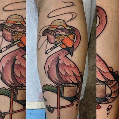 flamingo smoking a cigarette tattoo by green bay tattoo artists greg counard