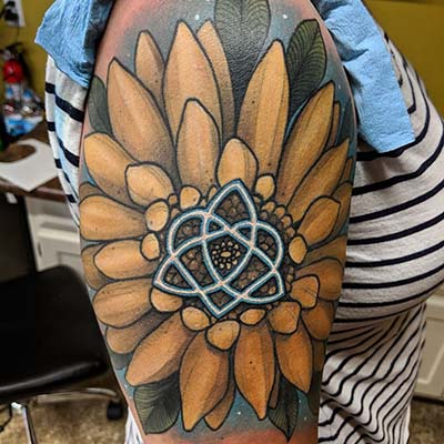 large flower tattoo by Greg Counard