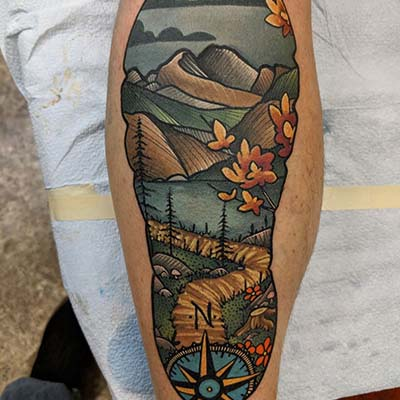 nature scene in the shape of a footprint tattoo by Greg Counard