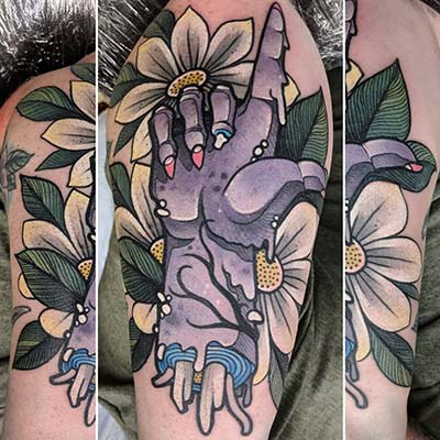 zombie hand in flowers tattoo by Greg Counard